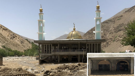 A mosque in Peshghor Village, Afghanistan, is covered by debris brought by the flood.